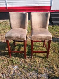 2 Tan Suede with wooden leg Barstools