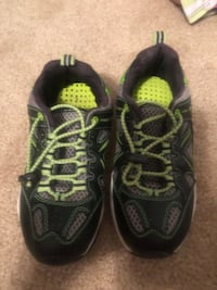 pair of black-and-gray running shoes 102 mi