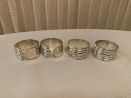 Four Silver Plated Napkin Rings
