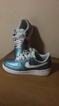 pair of blue-and-white Nike Air Force 1 low-top shoes