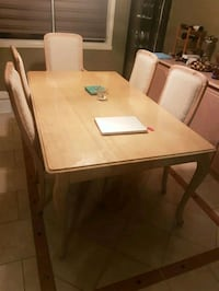 rectangular white wooden table with four chairs dining set