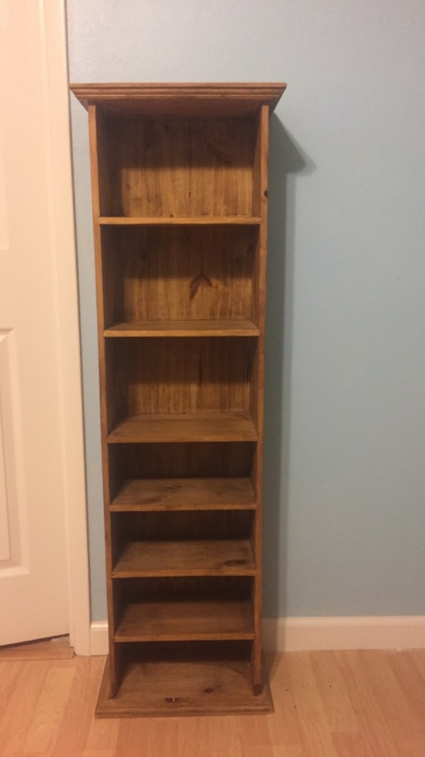 "Used Tres Amigos bookshelf. 7 shelves. 50"" tall x 15"" wide x 8"