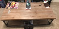 Brown wooden rolling coffee table. Alexandria, 22314