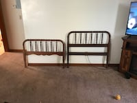pair of brown wooden headboard and footboard