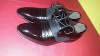 pair of black leather dress shoes Toronto, M9V 4C3