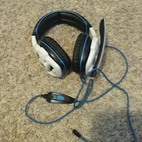 white and blue corded headset