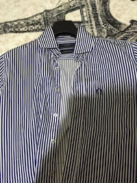 Blue and white stripe button-up shirt.