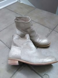 pair of gold leather boots