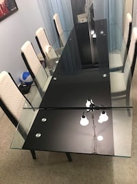 Modern glass dining/conference table and chairs 774 mi