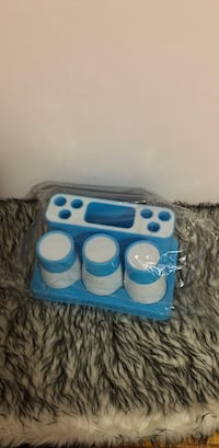 Brand new brushing cups and set in blue and white Burnaby, V5A 3V9