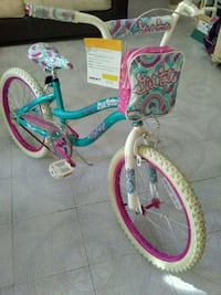 toddler's teal and pink bicycle 1495 mi