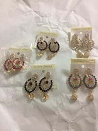 three pairs of silver-colored earrings Dollard-des-Ormeaux, H9B 1Y4