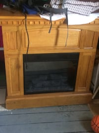 brown wooden framed electric fireplace Chicago, 60618