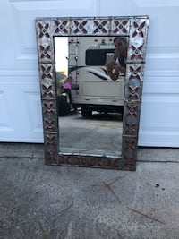 Rectangular framed mirror.  Frame is silver with red flowers. Charleston, 29412