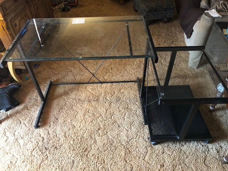 Computer table with roll away matching stand. Doesn't take up much space. Is in great condition .Black metal frame, and glass tops. f89d197f-ab80-46f0-b005-42de9032360b