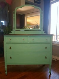 Refinished Dresser with tilting mirror on wheels  Lorette, R0A
