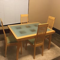 square brown wooden dining table with four chairs Newark, 43055