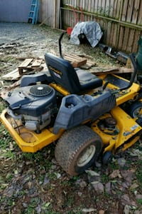 yellow and black ride on lawn mower Sterling, 20164
