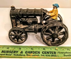 Early cast iron tractor and farmer driver