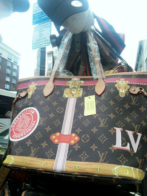a78f556c1a71 Used black and brown Louis Vuitton leather tote bag for sale in New York -  letgo