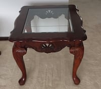 brown wooden framed glass-top coffee table 270 mi