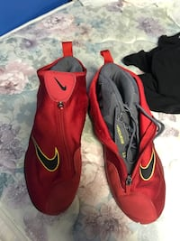 pair of red-and-black Nike cleats Sudbury, P3A