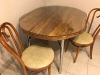 Dinette table with glass top and four (4) chairs.