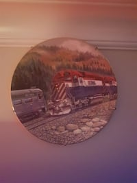 blue, white, and red train printed decorative plate