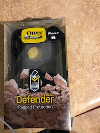 black OtterBox Defender Rugged Protection for iPhone 7 with box