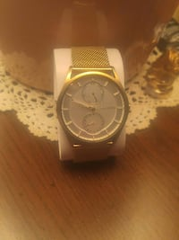 round gold-colored Skagen chronograph watch with strap