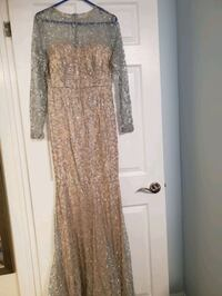 Brand new silver dress size medium  London, N6E 2H9