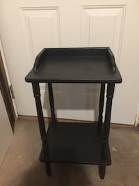 Antique telephone stand painted a chalk black