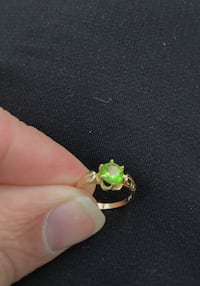 New.  14k yellow gold and peridot (August birthstone) girl's ring.  Solid gold.  Size 3.  Totally resizable.  Great gift for a girl in your life for the new year, baptism, christening  or birthday.   Beautiful solitaire design.  Each comes with a beautifu Corona, 92882