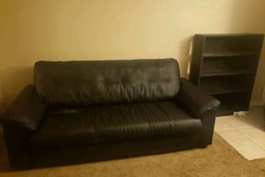 Black couch &matching shelf. Pick up required
