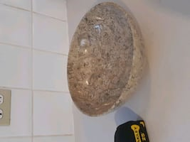 Marble bowl contains fossils