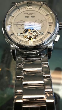 round silver Rolex chronograph watch with silver link bracelet