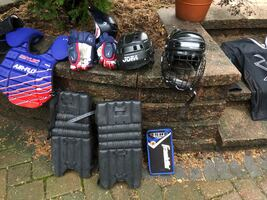 Selling my kids old hockey stuff... old time Mylec pads, waffle board, graphite shaft stick, ice hockey helmets, golf clubs , baseball tee. Buy the whole lot or just a few pieces. USA jersey is kids large , sharks jersey is adult medium