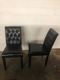 two black leather padded chairs Clinton