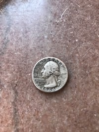 Round silver-colored coin New York, 11375