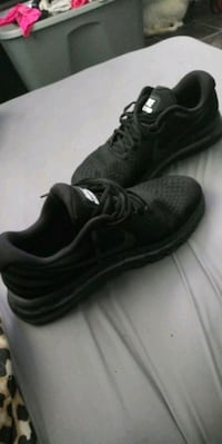 pair of black Nike low-top sneakers 861 mi