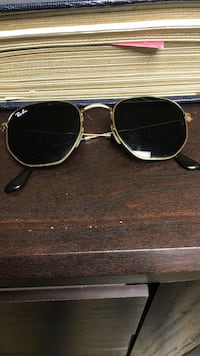 gold-colored framed Ray-Ban sunglasses