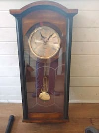 Antique hanging wall clock with pendant