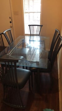 rectangular brown wooden table with six chairs dining set College Station, 77845