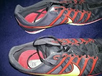 pair of black, red, and yellow spikes for track