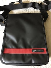 11inch traveling bag, for IPad, MacAir or tablet. Comes with reversible cover to the brown with orange and tan stripes.  Pinecrest, 33156