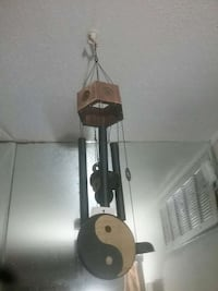 brown wooden black steel wind chime Houston