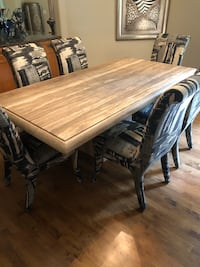 "Travertine table and six chairs. Table is 6 '8""x3'6"". Chairs are custom upholstered. Elkhorn, 68022"