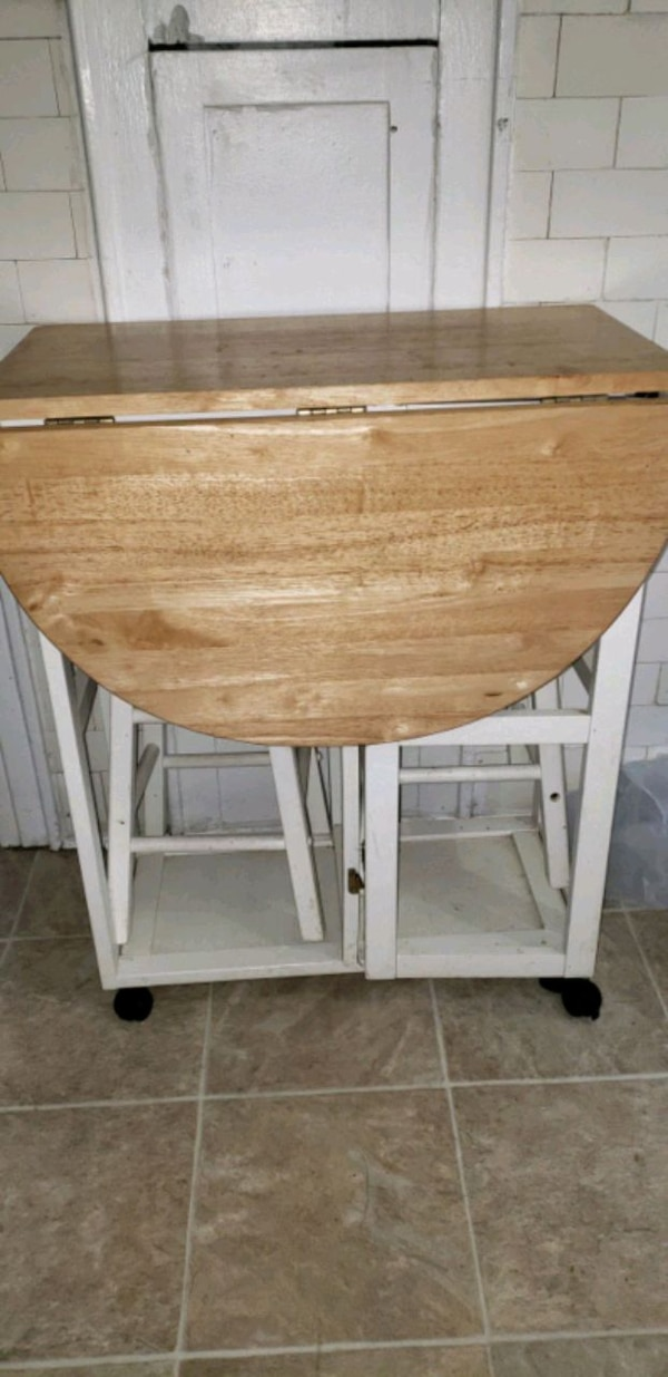 Folding table with two seats. Negotiable.