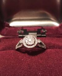 round Diamond and silver-colored ring
