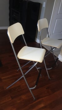 two stainless steel framed white wooden folding chairs bar stools  Markham, L6C 2A8